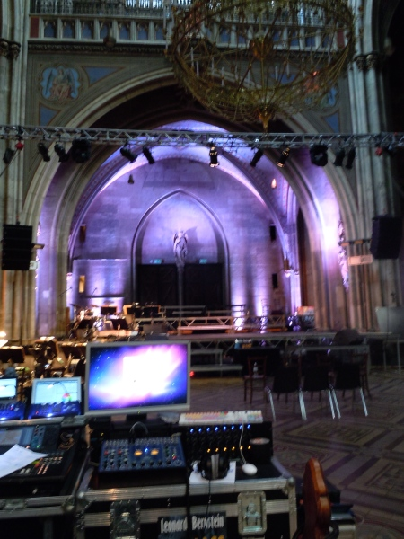 Church alcove lit up with purple lights behind imac and soundboard
